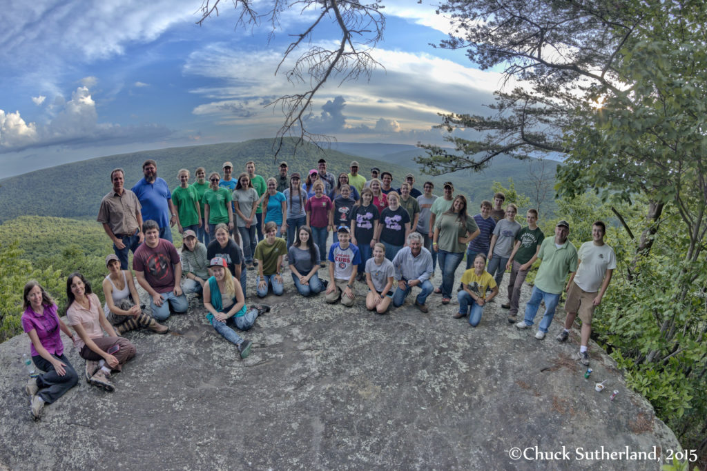 A 4-H group sits atop a mountain at Welch Point.